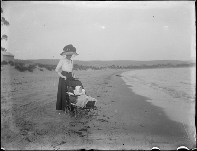 Woman with a baby in a pram on a beach, c 1900, by Edward William Searle (1887-1955), NLA Commons on Flickr