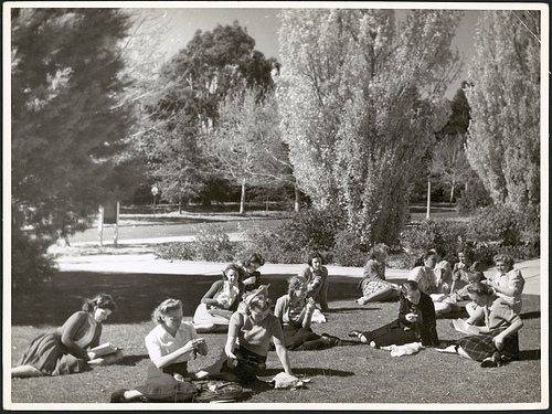 Young women sitting on grass eating lunch, Canberra, c 1948, NLA Commons on Flickr